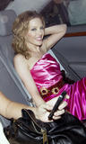 Kylie Minogue in pink dres and black fishnest stockings attends Dolce and Gabbana party in Cannes - Hot Celebs Home